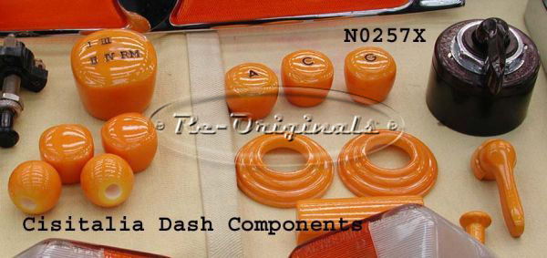 Dash knobs and interior knobs.  .  These are generally used on the Cisitalia.  The set is 9 pieces of all amber painted vintage porous plastic.  Included are 3 dash knobs that have the letters C, G and A, two window winder bezels of the same material, ash