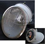 Headlight assembly, NOS, Carello, Euro version, prismed lens, open reflector in steel removable housing, steel carcass for lens that connects to reflector housing, chromed trim.  These are original to the Fiat 850 Spider, Euro version.  They can be used o